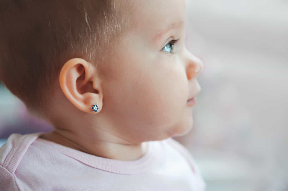 infant with ear piercing