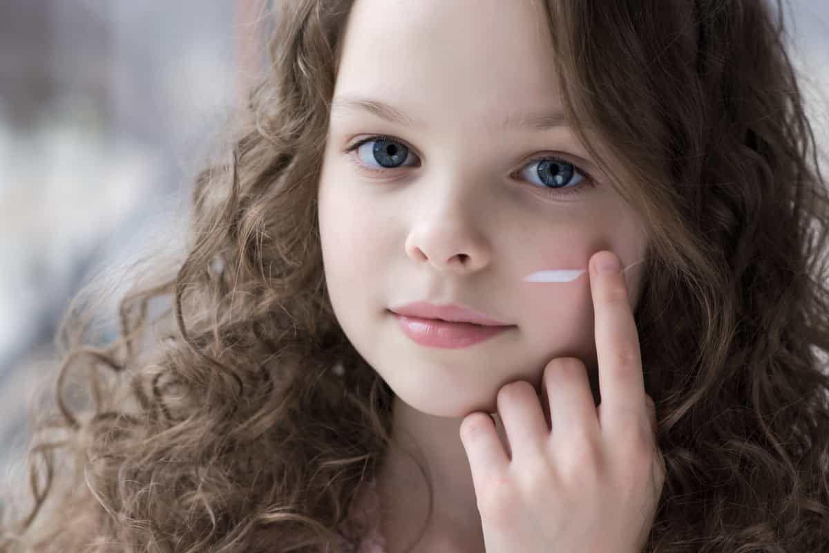 child with skin cream